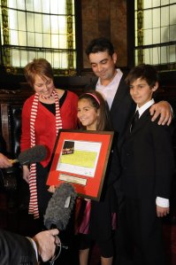 2009 Victorian Father of the Year Bruce Maya and his family are interviewed for the evening's news.