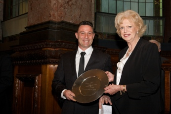 2011 Victorian Father of the Year Andrew Streader accepts the award from Deputy Lord Mayor Susan Reilly.