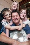 Father of the Year for 2014 Adam Strathairn with wife Simone and children Oscar and Ava.